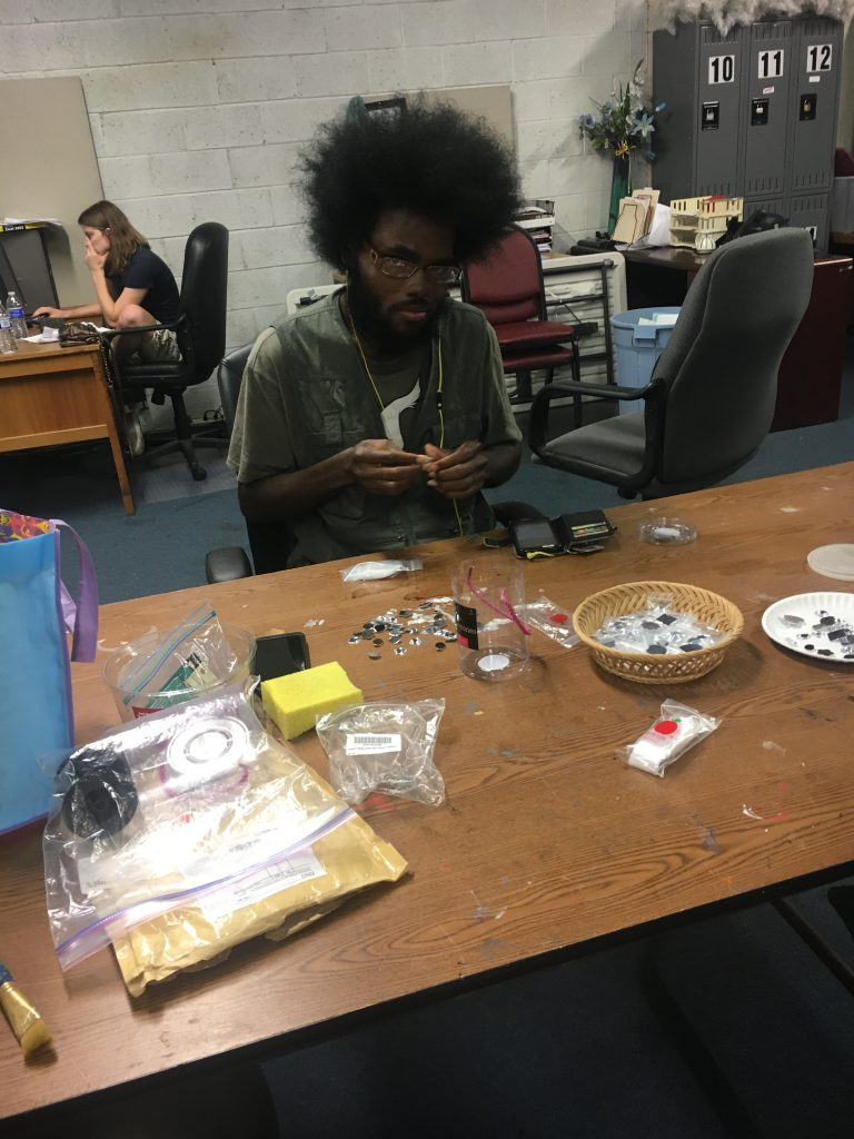 Dion filling baggies with crystals